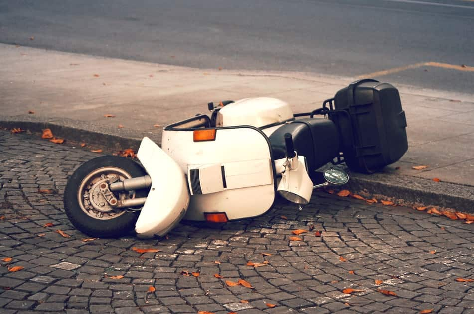 Scooter down on the street